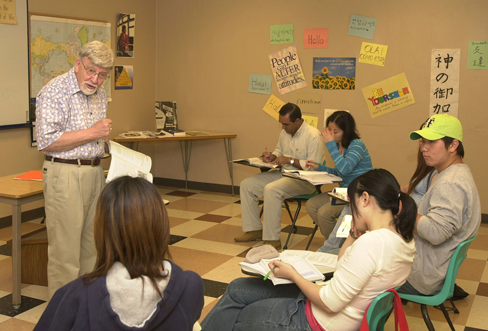 Hesston College professor Al Yoder explains a point during an ESL (English as a Second Language) course during the spring semester. Yoder is retiring from the college at the end of the present school year in early May.