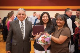 Celeste Begaye '10, center, with her parents Danny '94 and Lillian '95 Begaye.