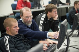 Computer faculty member Bob Harder works with a student