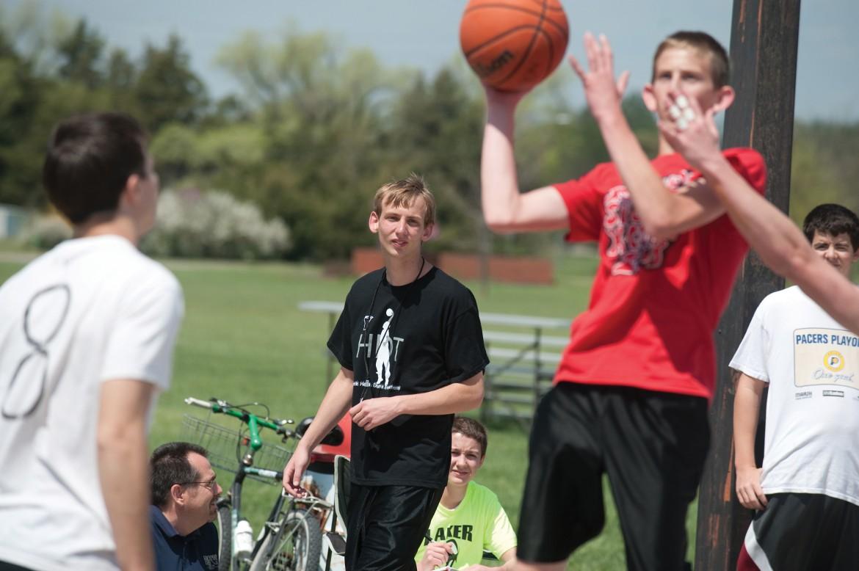 Entrepreneurship student John Oyer (center) refs a game during the three-on-three dunkball tournament he helped plan.