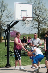 Hesston College Business faculty member David LeVan watches a three-on-three basketball tournament.