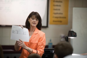 Faculty member Vickie Andres leads students in a class exercise.