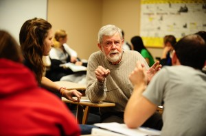 Dr. Robert Enns joins in a small group discussion with some of his Introduction to Sociology students.