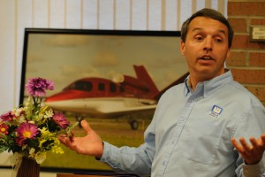 Mark Miller shares about serving others in his work as a flight instructor at Wells Aircraft in Hutchinson with Hesston College students, alumni, prospective students and faculty and staff during the college's annual Aviation as Mission event.