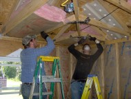 David Hochstetler (left) and John Schoenhals install insulation in a home in Picayune, Miss., during their fall break in 2009.