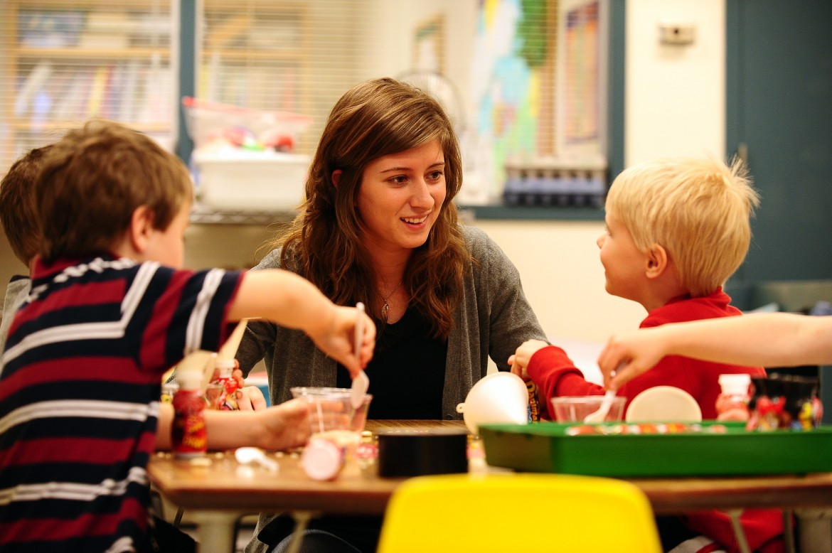 Hesston College sophomore Deb Yoder works with preschoolers in the Hesston College Lab Preschool. The preschool serves as a learning environment for both preschool children and for the college students who work with them.