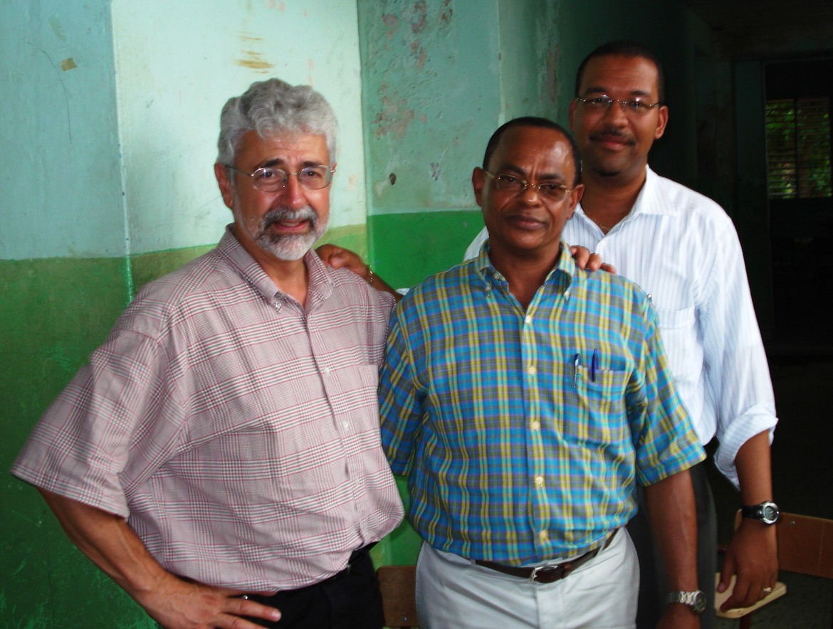 Glenn Smucker meets with Paulino Rosario Guerrero, mayor of Pedro Santana, Dominican Republic, and Cesareo Guillermo of Pan American Development Foundation on one of his short-term consulting trip.