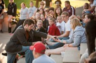 Cheritt Gingerich '00 performs a magic show during the Friday evening Tailgate Picnic and Family Festival.