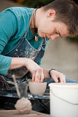 Art faculty member Hanna Eastin throws a teacup during a ceramics demonstration.