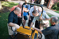 Brian Nebel '83 (far right) explains the Zeon Electric Mower to symposium attendees. Nebel is director of Engineering at Excel Industries in Hesston.