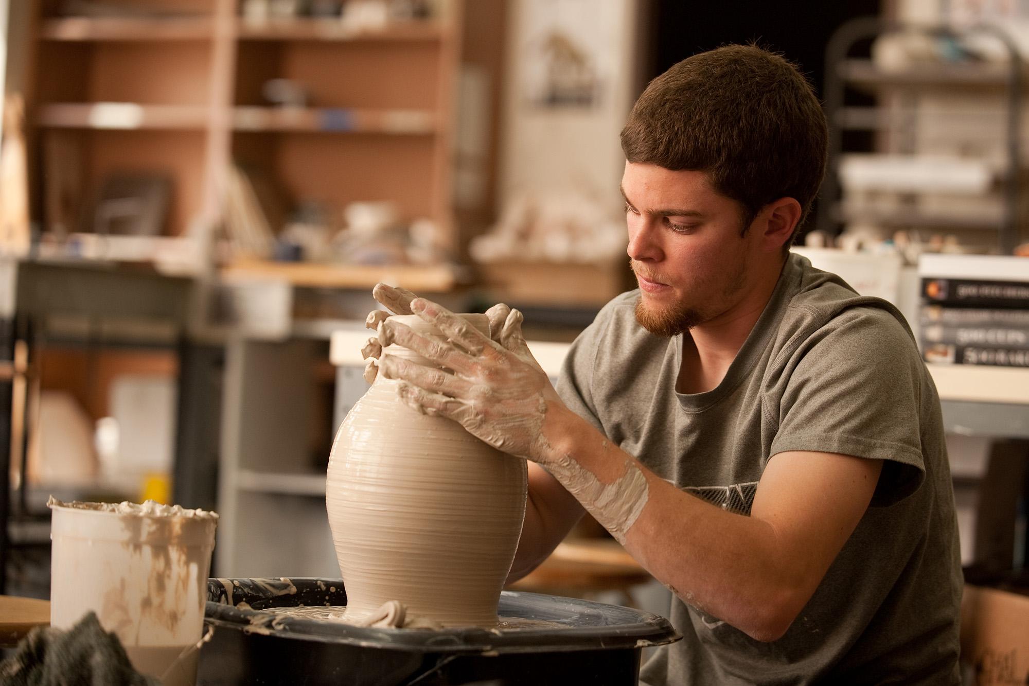 A student throws in the ceramics studio