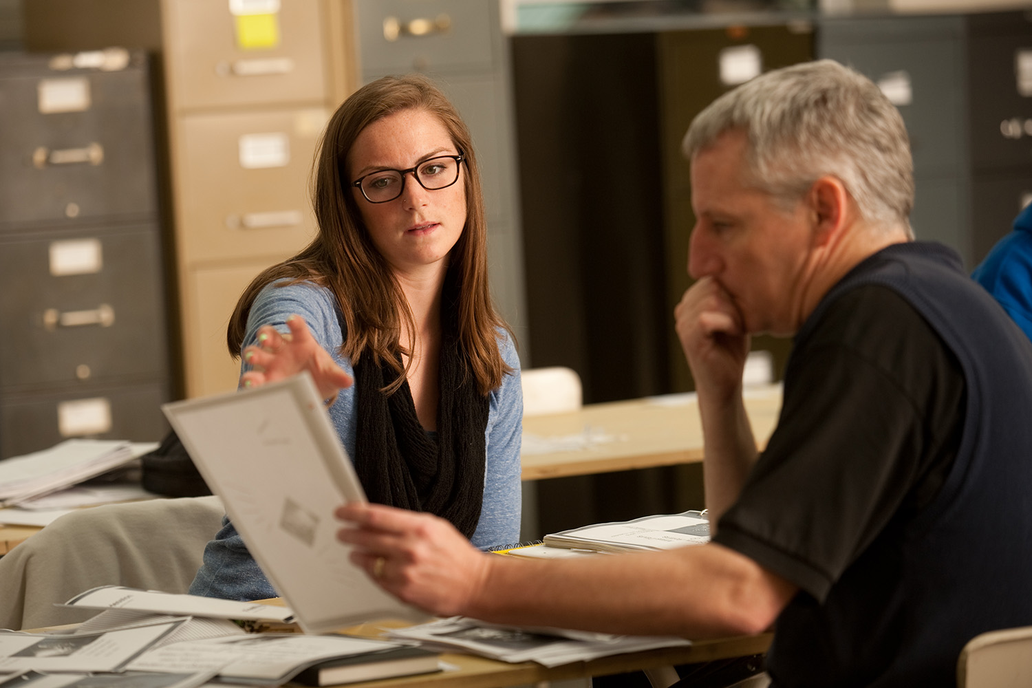 A student consults with graphic design prof Bruce Plank