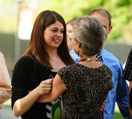 Heidi Zehr of Tiskilwa, Ill., receives a hug and encouraging words from faculty member Maria Day.