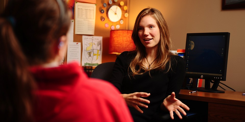 Hesston College counselor Julie Lehman visits with a student.