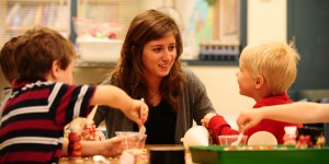 Deb Yoder works with preschoolers in the Hesston College Lab Preschool. The preschool serves as a learning environment for both preschool children and for the college students who work with them.