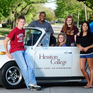 Hesston College students with the college's VW Super Beetle