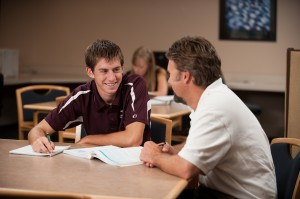 Elliot Wilder '11, Hesston, Kan., gets help from business faculty David LeVan in the ACCESS lab.