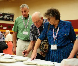 Don Ac56, '61 and Debbie Diller of Phoenix, Ariz., place a bid on a silent auction item.