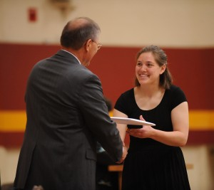 Annali Murray receives her diploma from Hesston College President Howard Keim