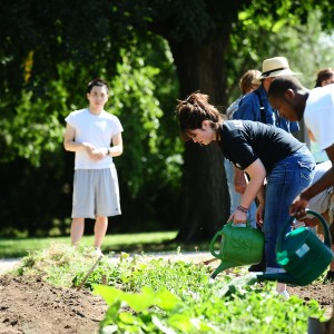 Dulaney Arzola of Stafford, Kan., and other students in the First Year Experience seminar work in the Intergenerational Community Garden.