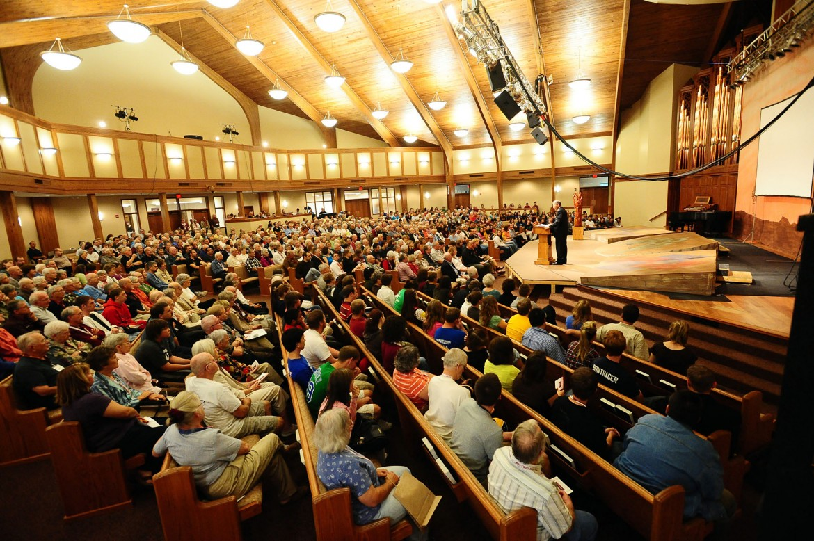 A crowd gathers in Hesston Mennonite Church for homecoming chapel