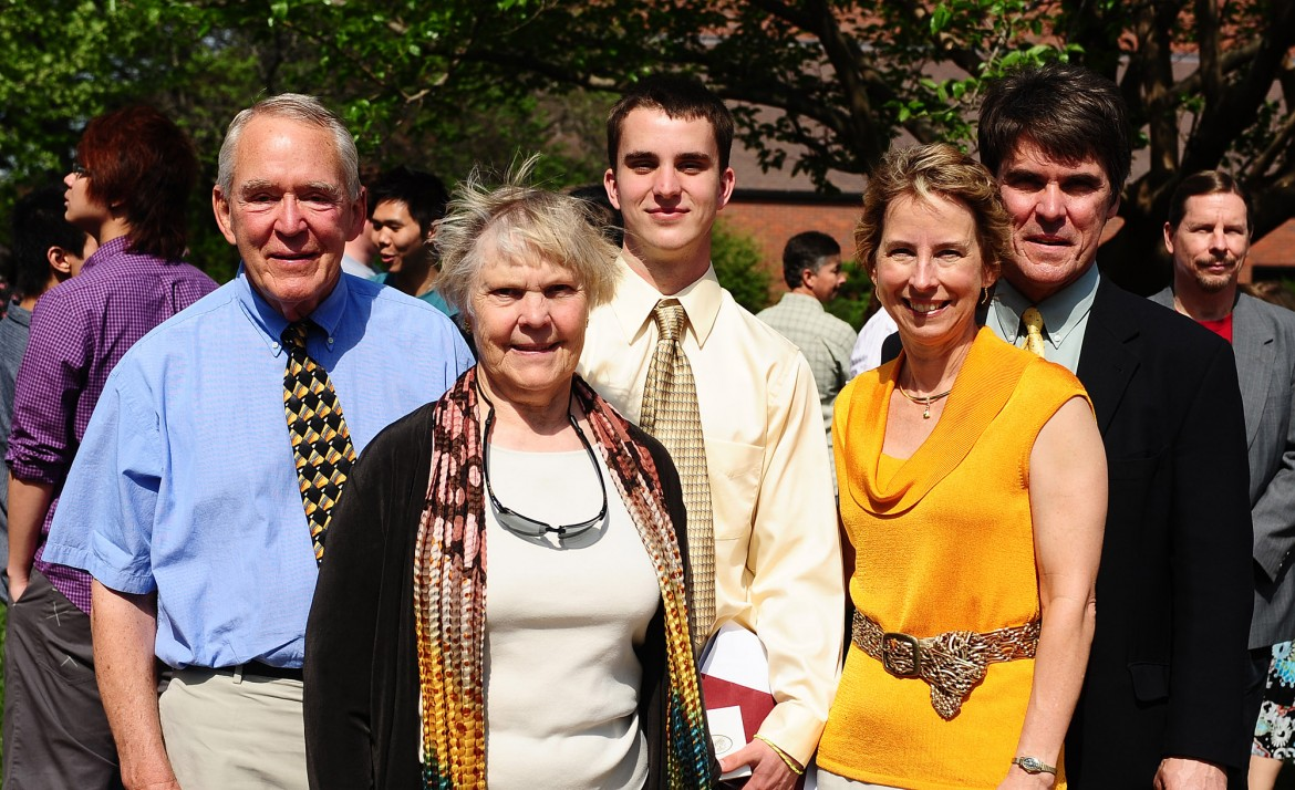 Mark Rombold (center) with his grandparents, Peter and Shirley Rombold (left), and parents, Peter and Marty Rombold (right), following commencement May 8.