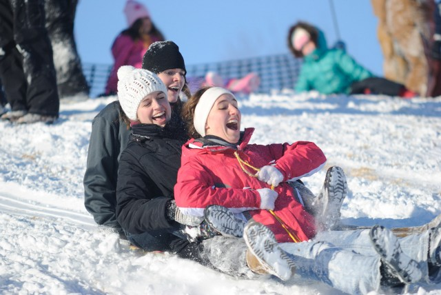 Hesston students enjoy the town's sledding hill on a snowy day.