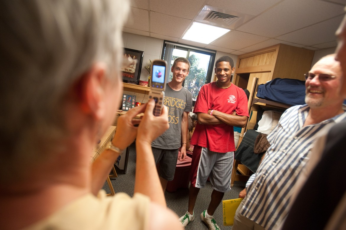 Freshmen roommates David Rudy (Manheim, Pa.) and Michel Anderson (Wichita, Kan.) pose for Rudy's mother, Carolyn, as they moved in to Kauffman Court at the beginning of the year.