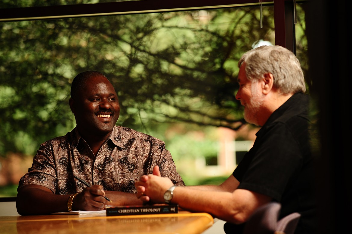 Ron Moyo discusses class concepts with Tim Lichti, Director of the Hesston College Pastoral Ministries program.