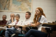 Heather Harkins '12, an air traffic control student from Wichita, Kan., listens to a symposium presentation.