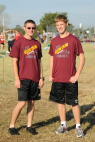 Freshman Jacob Landis (left) and sophomore Kenny Graber (right) are following in their fathers' footsteps as runners at Hesston.