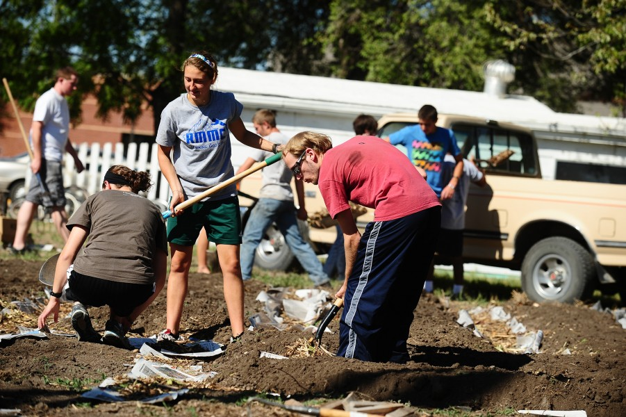 Sophomore Krista Rittenhouse (Mount Pleasant, Pa.) and Fritz Lehman (Dalton, Ohio) work in the community garden. Volunteers built raised beds for planting, created mulch paths and constructed compost bins.