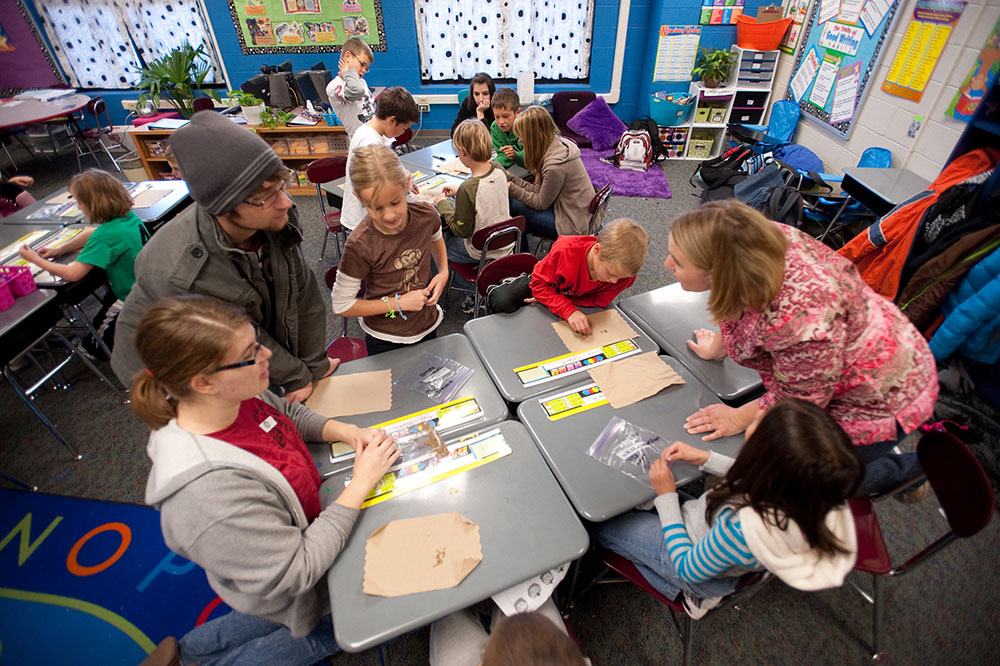 Hesston College Environmental Biology students work with Hesston Elementary third graders.