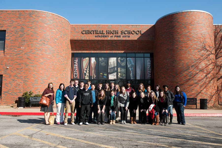 The Hesston College group poses outside Tulsa Central Junior High and High School after their day of observing and working with students.