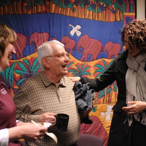 Bill Mason (center), longtime Hesston College employee, is congratulated by Melissa Unruh (left) and Rachel Swartzendruber Miller (right) during Mason's retirement celebration at Hesston College Feb. 16.