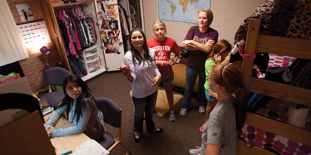 Sophomores Brenda Nieto-Montoya (Three Rivers, Mich.) and Andrea DeAvila Balboa (Matamoros, Tamaulipas, Mexico) show off their newly renovated dorm room to Homecoming 2011 guests Kailie Hamilton, Angie (Maury) '94, staff Teeter, Rachel Teeter and Kailey Ince.