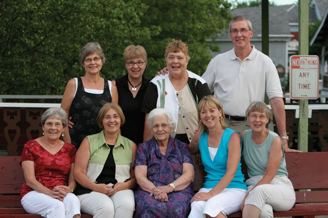 "Back row from left: Marilyn (Kauffman) Ac55, '57 Miller; Bonnie (Kauffman) Ac65, '67 Sowers; Joy (Kauffman) Ac57 Sears; ""Junior"" Kauffman Ac63, '69  Front row from left: Betty (Hostetler) Ac53, '55 (Kauffman) Schmidt, Charles' wife; Gloria (Kauffman) Ac61, '63 Yoder; Clara Kauffman; Phyllis (Kauffman) '74 Hysong; Evelyn (Kauffman) Ac59, '61 Schellenberger. Courtesy photo taken shortly before Clara's death in 2006."