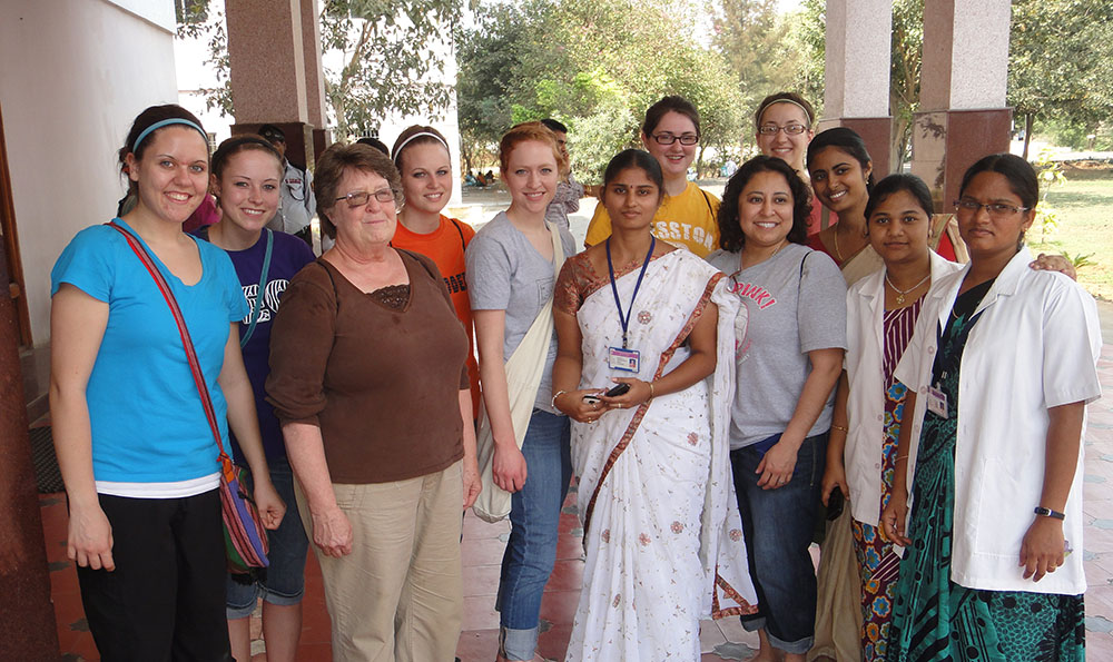 Seven Hesston College nursing students and one instructor spent two-weeks in Chiluvuru, Andhra Pradesh, India during a two-week extended spring break trip. Pictured from left with staff at the Siddartha Medical College, Nursing School and Hospital are Anna Yoder (Garden City, Mo.), Logan Duerksen (Newton, Kan.), Jean Rodgers, Hesston College nursing instructor, Kara Ropp (Kalona, Iowa), Rachel Tippin (Elbing, Kan.), Rachelle Wenger (Adair, Okla.), Andrea Delgado (Hutchinson, Kan.) and Grace Schmidt (Wichita, Kan.).