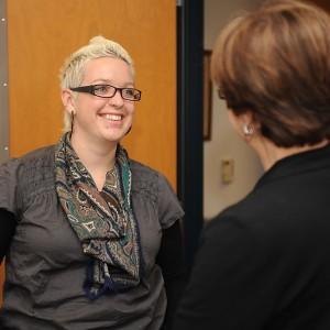 Rachel Neufeld, 2001 Hesston College graduate, talks with Hesston's Director of Nursing Bonnie Sowers.
