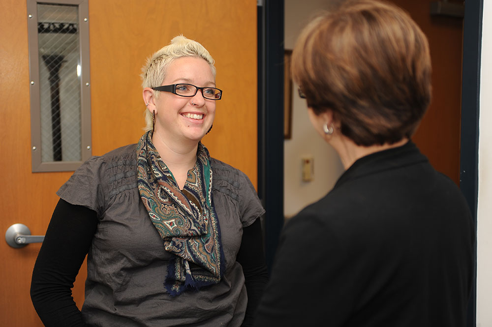 Rachel Neufeld, 2001 Hesston College graduate, talks with Hesston's Director of Nursing Bonnie Sowers.