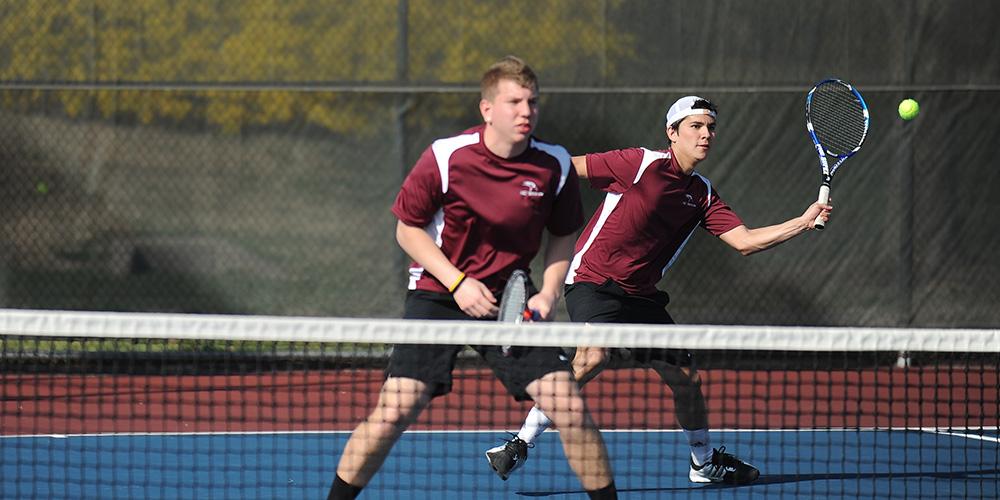 Hesston College men's tennis action photo