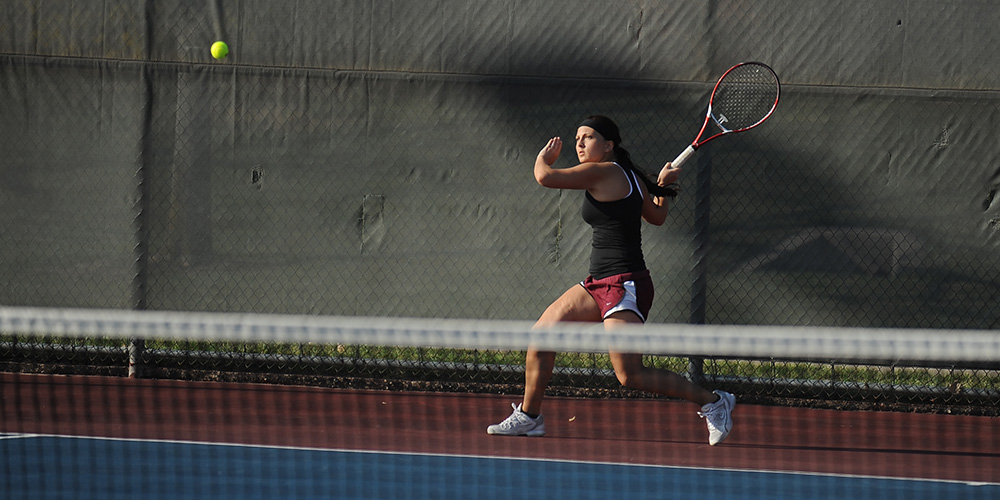 Hesston College women's tennis action photo