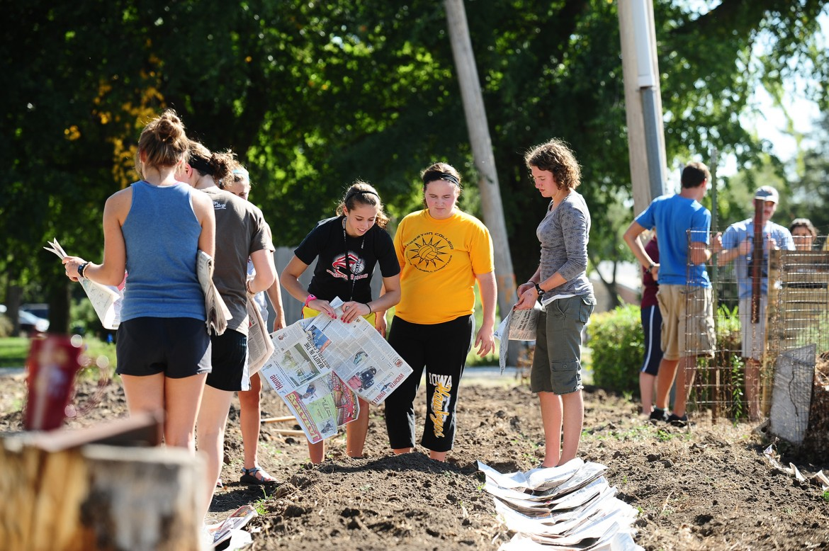 Molly Nebel (Hesston, Kan.), Renita Miller (Kalona, Iowa) and Leah Rittenhouse (Mount Pleasant, Pa.) prepare the campus garden for spring planting during Hesston College's No Impact Week in September 2011. The garden is one focus of the college's Earth Day celebration April 19.