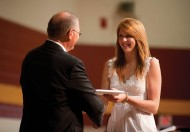 Kate Steury (New Paris, Ind.) receives her diploma from President Keim.
