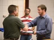 Josh Musser (Newport News, Va.) receives recognition of completion from Disaster Management Program Director Russ Gaeddert.