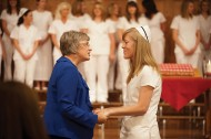 Erica Fitzmorris (Littleton, Colo.) receives a blessing of the hands from faculty member Sondra (Wedel) '80 Leatherman during the 45th nursing pinning.