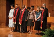 "Pastoral Ministries graduates and their wives receive a prayer of blessing from Bible and Ministry faculty and staff. Pictured from left are Ude Chukwuyere Chukwukelu, Chijioke ""C.J."" Chukwukelu, Ronald Moyo, Sukuluhle Moyo, Jolene Miller and Bryan Miller."