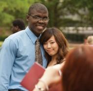 Hesston College graduates Aaron Jones (Kansas City, Mo.) and Saki Nozaki (Tokyo, Japan) pose for a picture following commencement May 6.