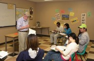 Al Yoder with students in his English as a Second Language classroom