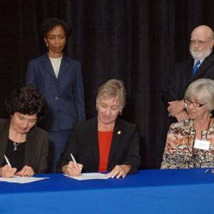Dr. Sandra Zerger, Vice President of Academics at Hesston College, and Dean of the University of Kansas School of Nursing, Karen Miller, RN, Ph.D., FAAN, sign an articulation agreement for nurses.
